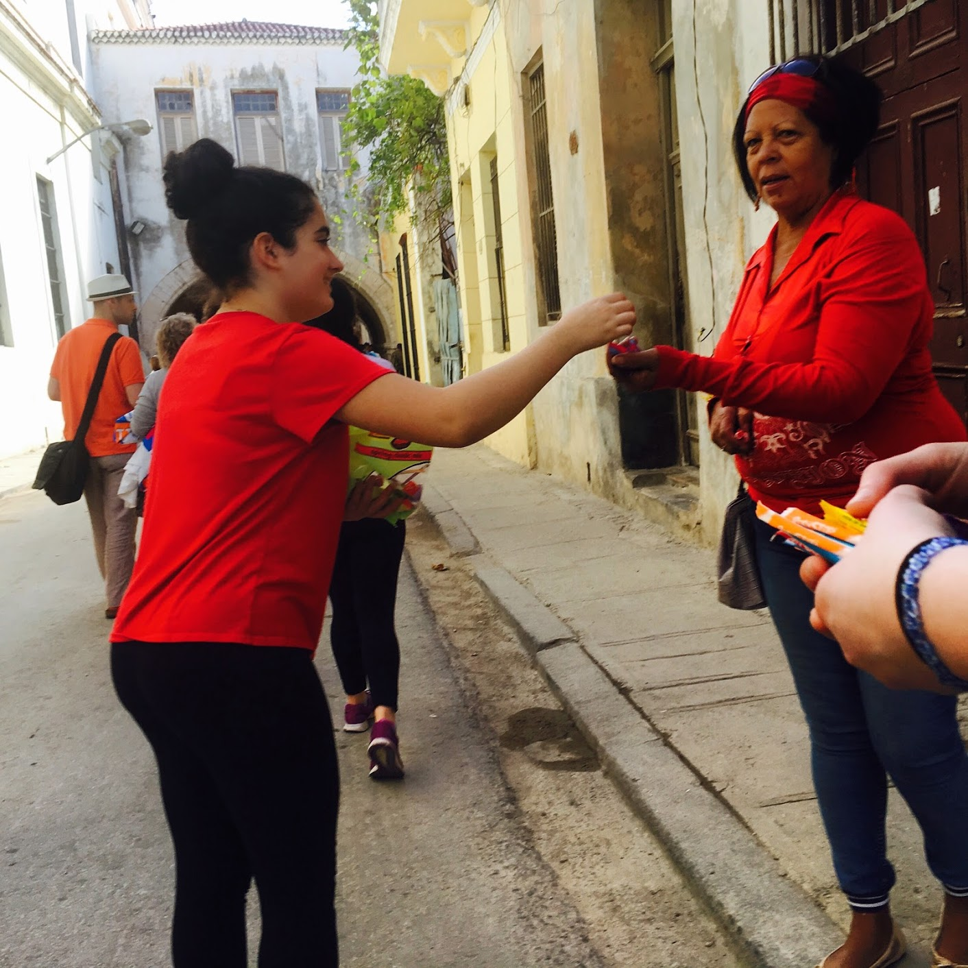 Handing out candy on the streets of Havana